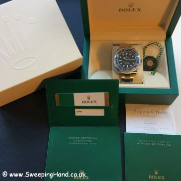 2018 Rolex 114060 with Guarantee Papers